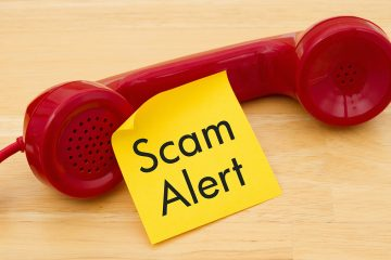 """<a href=""""https://www.bigstockphoto.com/image-151458713/stock-photo-getting-a-call-that-is-an-scam-a-retro-red-phone-with-yellow-sticky-note-on-a-desk-with-text-scam-alert"""">red phone (bigstock.com)</a>"""