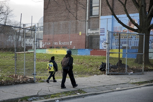 Two young students walking to Robert Fulton Public School on Thursday morning. (Bas Slabbers/for NewsWorks)