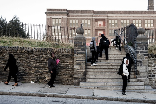 Students arriving at Roosevelt Elementary on Washington Lane the day it was announced that the school was among 37 that could soon close. (Bas Slabbers/for NewsWorks)