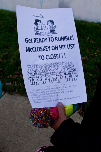 <p><p>The grandmother of two McCloskey students holds a flyer given out by a concerned parent after the end of school hours Thursday. (Brad Larrison/for NewsWorks)</p></p>