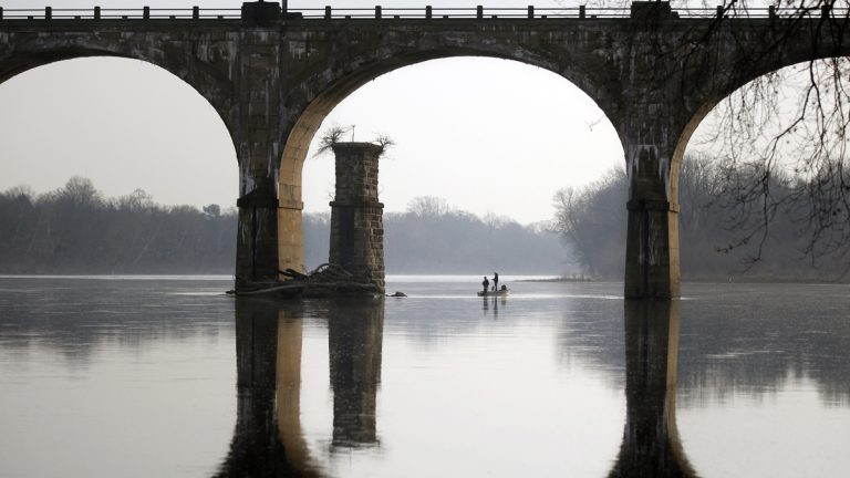 People take advantage of unseasonably warm weather to fish on the Delaware River near Yardley, Pa. (AP Photo/Mel Evans)
