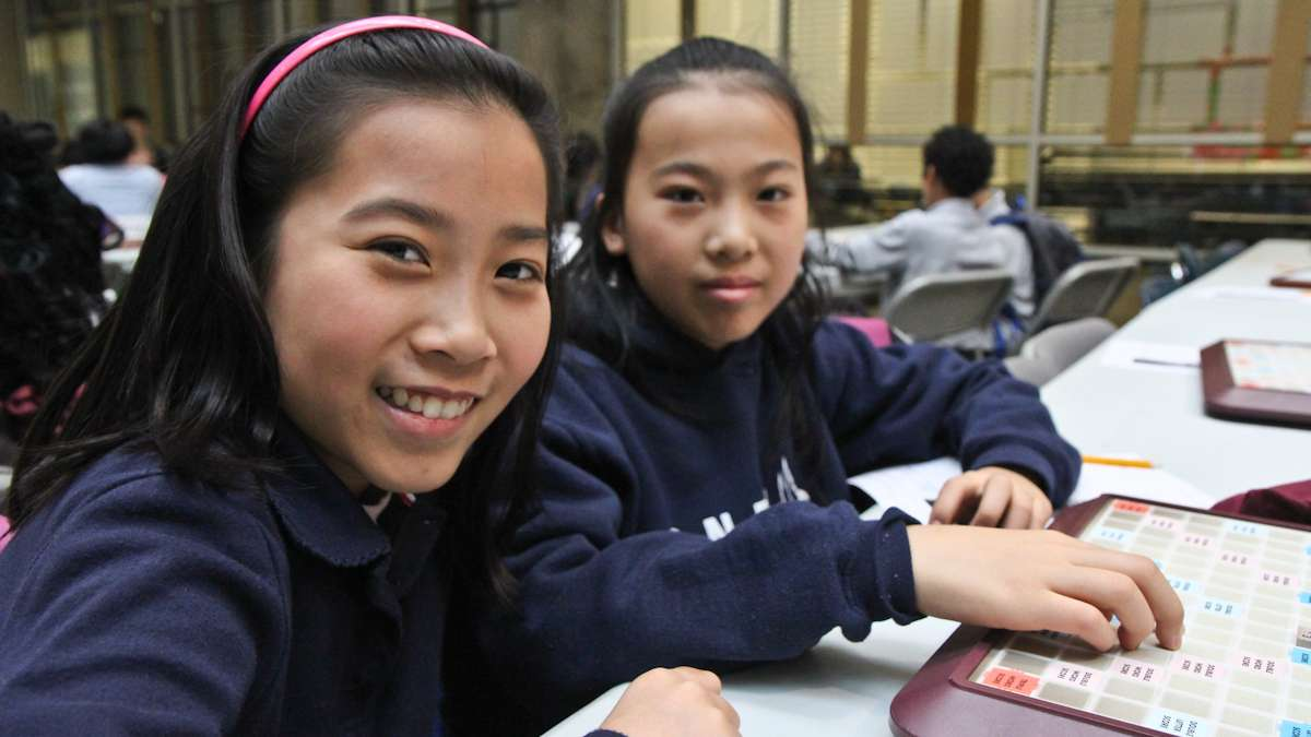 Rachel Goa, 12, and her sister Lexi, 11, say Scrabble helps them make friends. (Kimberly Paynter/WHYY)