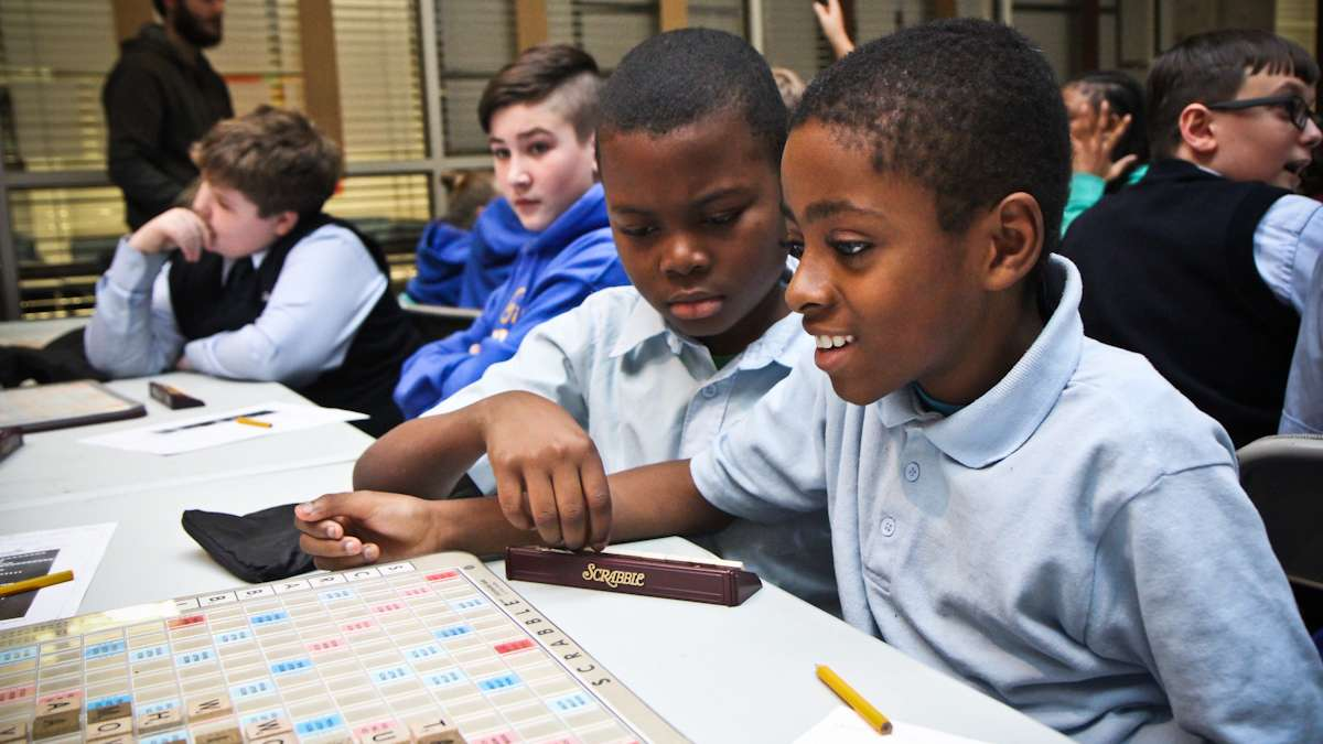 Kyseem Taylor, 10, and Tashan Watson, 11, of Richard R. Wright elementary play Scrabble in a tournament at school district headquarters Wednesday afternoon. (Kimberly Paynter/WHYY)