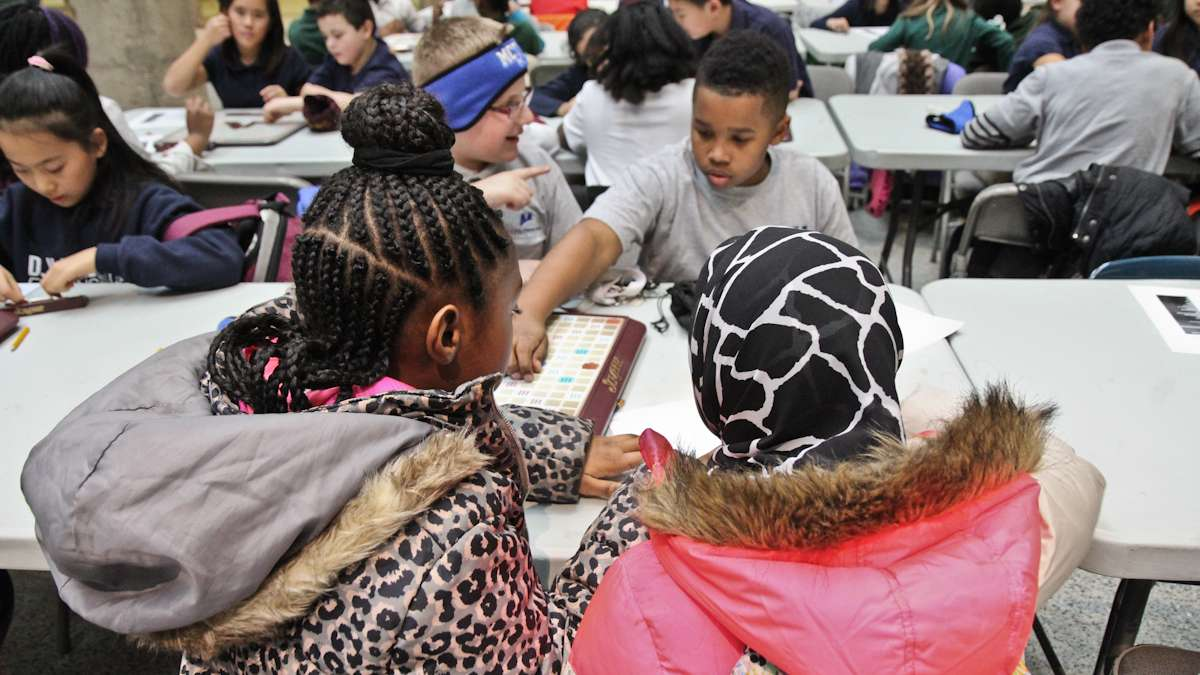 Kids at the ASAP Scrabble tournament say that making friends is a great benefit of the game. (Kimberly Paynter/WHYY)