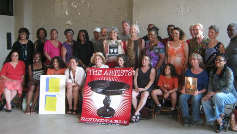 Members of the Germantown Artists Roundtable pose for a group portrait inside the since-closed Town Hall. (Alaina Mabaso/for NewsWorks)