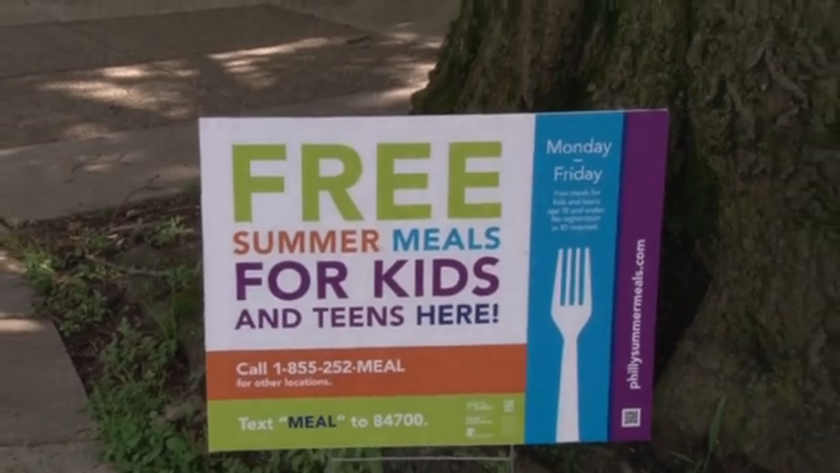 A sign outside Lovett notes that free meals are available for kids during the summer. (Brianna Michelle Bosak and Elizabeth Diane Sim/for NewsWorks)