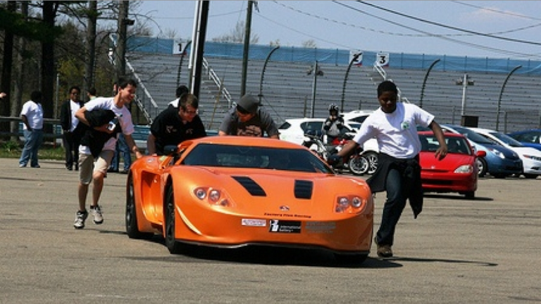 Members of West Philly High's EVX Team at Watkins Glen for the Green Grand Prix. (Courtesy of West Philly Hybrid X Team)