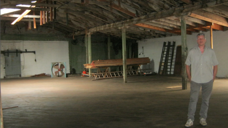 Jim Hamilton gives a tour of what will be the Rittenhouse Soundworks Arts Complex. (Alaina Mabaso/for NewsWorks)