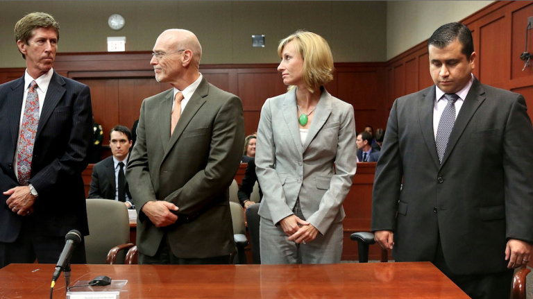At the moment the verdict is read, George Zimmerman, right, looks down as his defense co-counsel, Don West, second from left, and Lorna Truett, look at Zimmerman's lead defense attorney Mark O'Mara, left, as the verdict is announced in Seminole Circuit Court in Sanford, Fla. on Saturday. Jurors found Zimmerman not guilty of second-degree murder in the fatal shooting of 17-year-old Trayvon Martin in Sanford, Fla. (AP Photo/Joe Burbank, Pool)