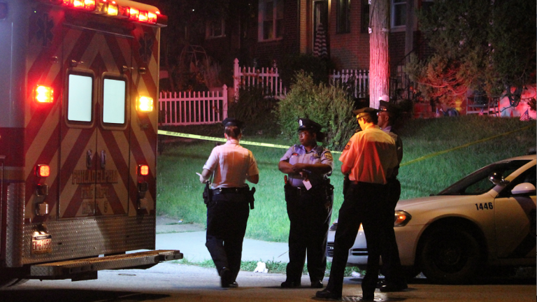 Police on the scene of Monday night's double shooting in Cedarbrook. (Matthew Grady/for NewsWorks)