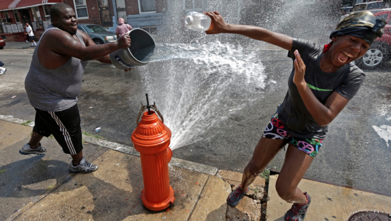 People play in water from an open fire hydrant during the afternoon heat, Wednesday, July 18, 2012, in Philadelphia. (AP Photo/Matt Rourke)