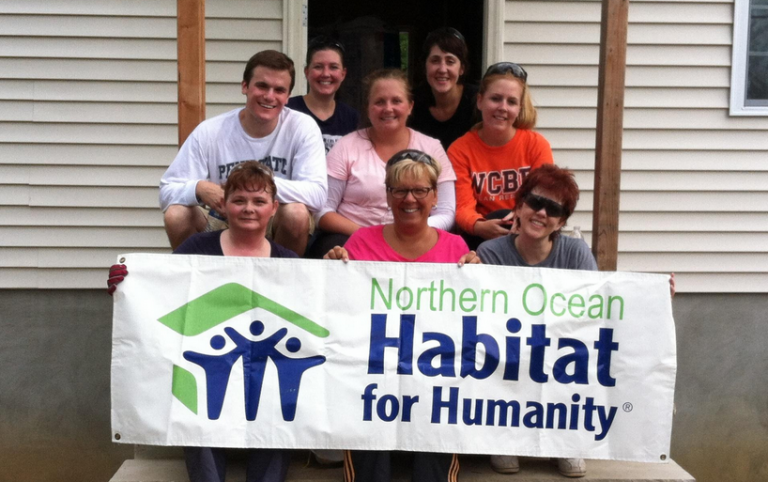In Aug. 2013, Johnson & Johnson employees helped install insulation in a house under construction. (Photo courtesy of Northern Ocean Habitat for Humanity)