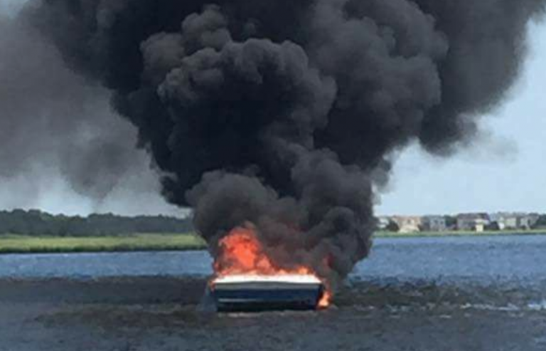 A boat fully engulfed in flames near Mystic Island Monday afternoon. (Image: Dennis C. Seeley Jr. via Mystic Island Volunteer Fire Company on Facebook)