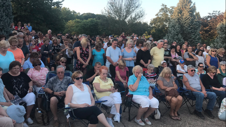 Hundreds show up to vigil in Bucks County to remember the four missing young men who were murdered by two cousins here. (Bobby Allyn / WHYY)