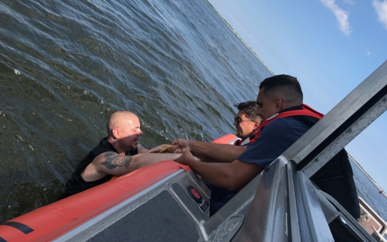 U.S. Coast Guard personnel rescuing a man from the water off Highlands Saturday afternoon. (Image: USCG)