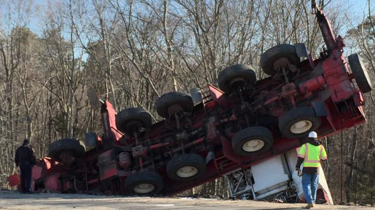 A construction worker suffered serious injuries Saturday morning after a crane he was operating on the Garden State Parkway toppled down an embankment and ejected him, authorities said. (Photo: JSHN contributor Alex Halsey)
