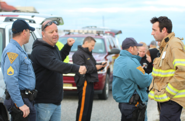 Authorities take a statement from an unidentified eyewitness near the beach in Cape May late this afternoon. (Photo courtesy of John Cooke)