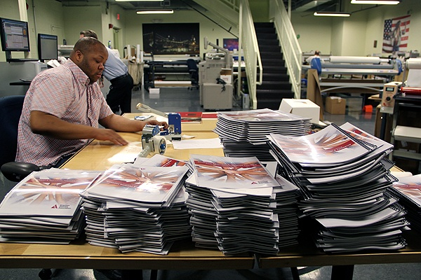<p>Work piles up at Keith Leaphart's busy print shop on 18th Street in Center City. (Emma Lee/for NewsWorks)</p>