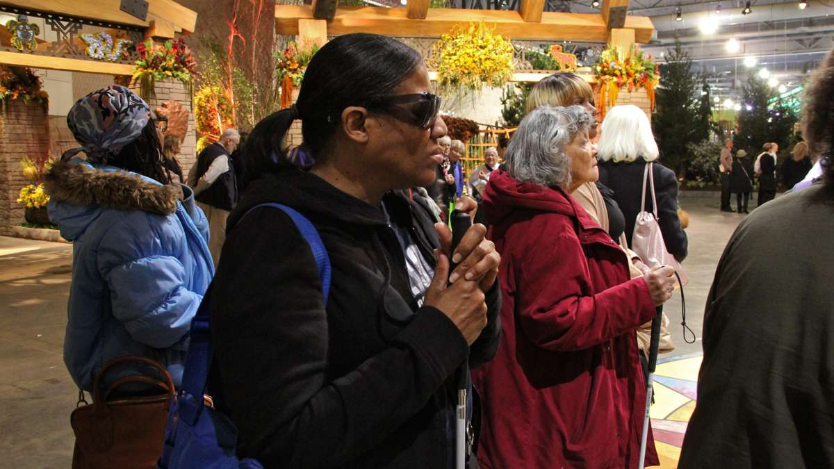 Blind visitors arrive at the Philadelphia Flower Show exhibit hall for a guided tour.