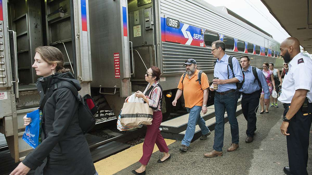 Passengers at the Ardmore Station board a SEPTA train to Philadelphia. (Jonathan Wilson for Newsworks)