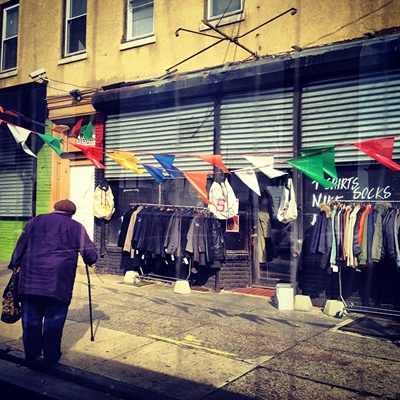 <p><p>Flags add some color to a clothing merchant's storefront in Southwest Philly. (Emma Fried-Cassorla/Philly Love Notes)</p></p>
