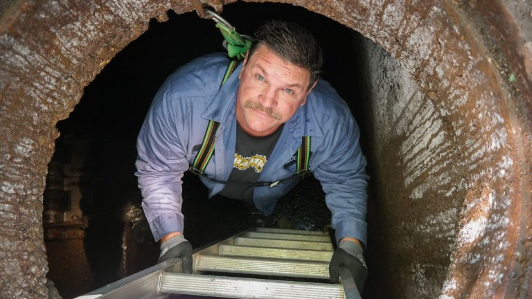 Donny Smith descends into one of the Pittsburgh sewer authority's