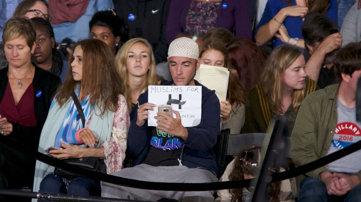Jonathan Lee Riches (center) is seen in the audience of an Oct. 4, 2016, Family Town Hall event with with Hillary and Chelsea Clinton, in Haverford, Pennsylvania, where he claims to be a Muslim supporter of the Democratic presidential nominee while the same man was seen three days earlier claiming to be a Muslim supporting Trump at a rally in Manheim. (Bastiaan Slabbers for NewsWorks)
