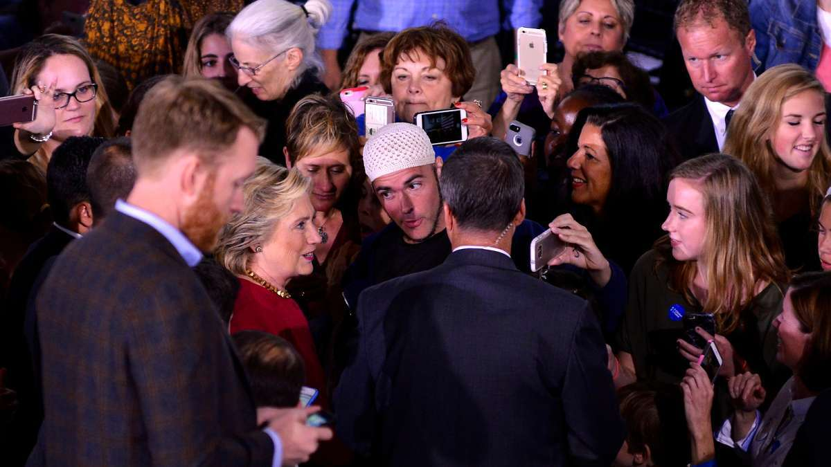 Johathan Lee Riches, who says he is a Muslim supporting Hillary Clinton, gets close to the Democratic presidential candidate during a Town Hall meeting in Haverford, Pennsylvania on Oct. 4, 2016. (Bastiaan Slabbers for NewsWorks)