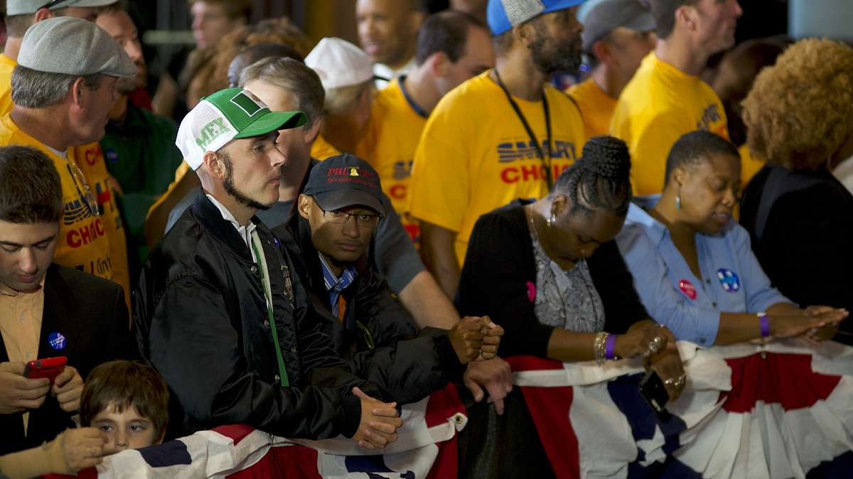Jonathan Lee Riches is seen in the front row at a rally with Vvce presidential candidate Tim Kaine on Oct. 5, 2016, at Sheet Metal Workers Local Union 19 Hall in Philadelphia. Riches wears a hat and shirt in the national colors of Mexico but he claims not to be Mexican himself but only representing hard working legal Mexicans nationwide. (Bastiaan Slabbers for NewsWorks)