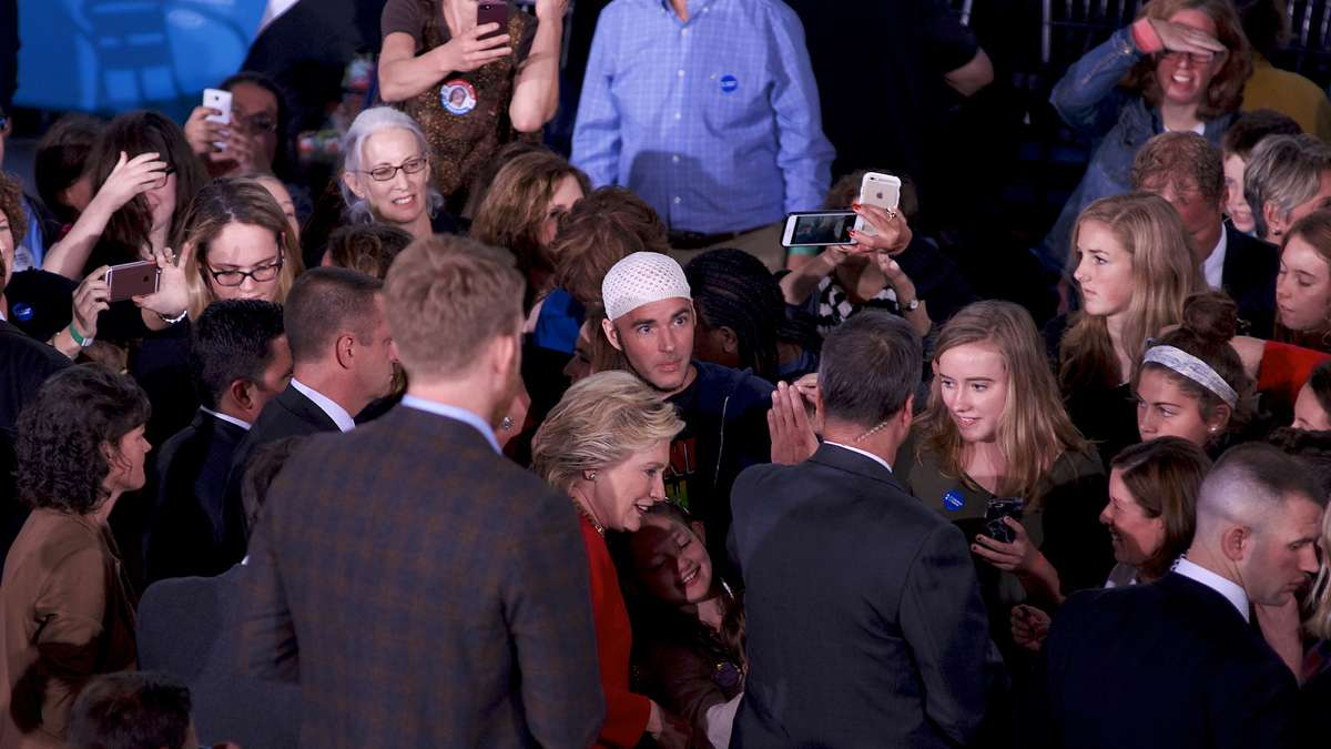 Jonathan Lee Riches is seen in close proximity with Democratic presidential nominee Hillary Clinton as she greets and takes selfies with voters after an Oct. 4, 2016 Family Town Hall in Haverford, Pennsylvania. (Bastiaan Slabbers for NewsWorks)