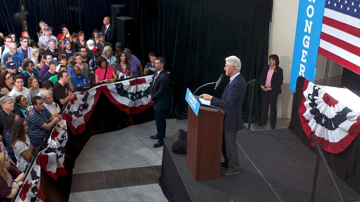 Jonathan Lee Riches is seen in the crowd (wearing a blue baseball cap backwards) at an event with former President Bill Clinton at Montgomery County Community College, in Blue Bell, Pennsylvania, on Oct. 18, 2016. (Bastiaan Slabbers for NewsWorks)