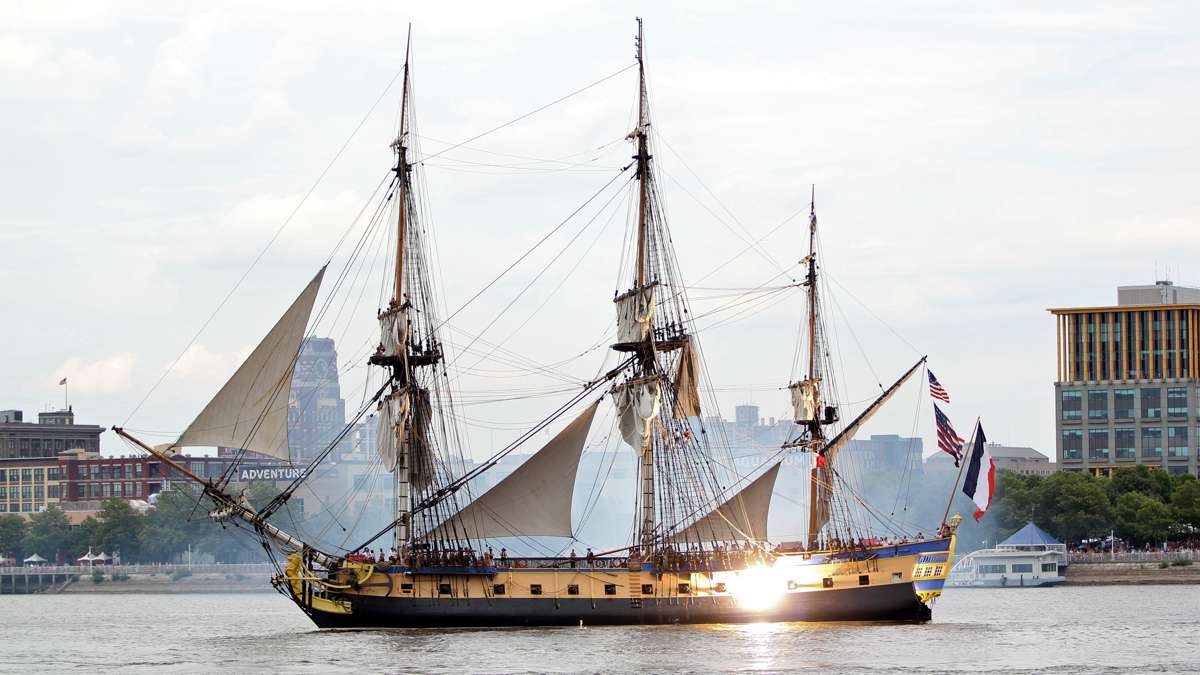 L'Hermione, a replica of the Marquis de Lafayette's 18th century ship fires her cannons as she arrives for the four-day Tall Ships Festival in Camden and Philadelphia. (Emma Lee/WHYY)
