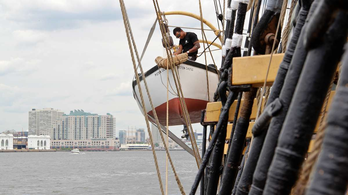 Gabe St-Denis looks after the ships tender aboard the Picton Castle as it arrives in Philadelphia. (Emma Lee/WHYY)
