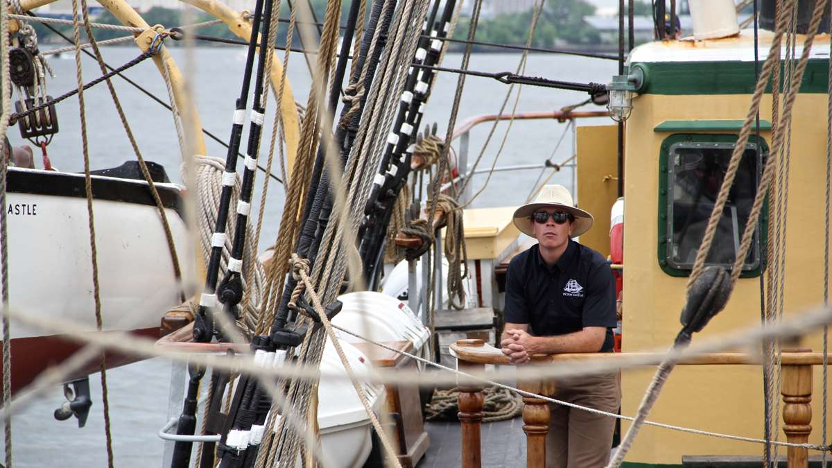 Capt. Sam Sikkema guides the Picton Castle as it cruises up the Delaware River. (Emma Lee/WHYY)