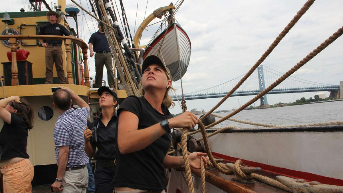 Bos'n Erin Greig checks the lines as the Picton Castle gets underway leading the Parade of Ships  in the Tall Ships Festival on the Delaware. (Emma Lee/WHYY)