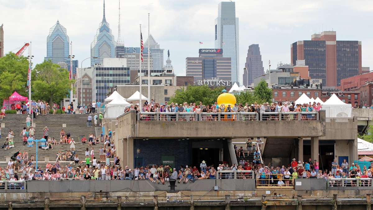 Crowds gather near the Independence Seaport Museum to watch the tall ships arrive in Philadelphia. (Emma Lee/WHYY)
