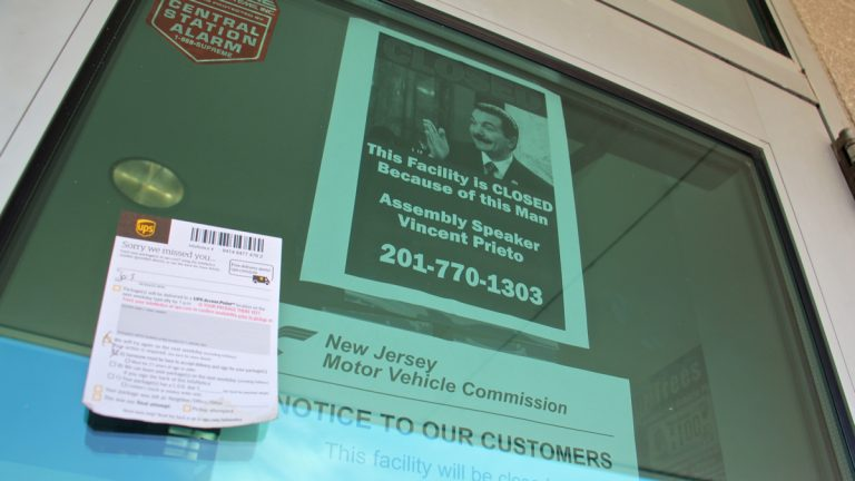 A sign on the door at the Motor Vehicle Commission facility in Cherry Hill lays the blame for the government shut down on Assembly Speaker Vincent Prieto. (Emma Lee/WHYY)