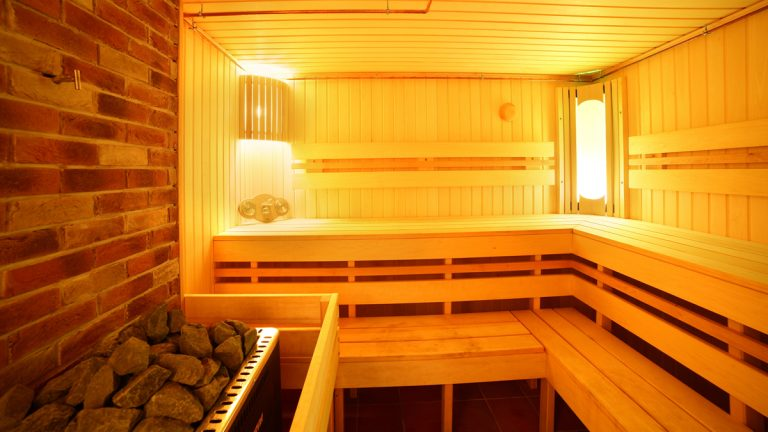 (<a href='http://www.shutterstock.com/pic-226918831/stock-photo-bright-and-hot-interior-of-modern-russian-sauna.html?src=csl_recent_image-1'>Russian sauna</a> image courtesy of Shutterstock.com)