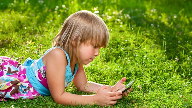 (<a href='http://www.shutterstock.com/pic-221280079/stock-photo-little-girl-usng-a-touch-pad-in-a-summer-garden.html'>Little girl using a tablet computer</a> image courtesy of Shutterstock.com)