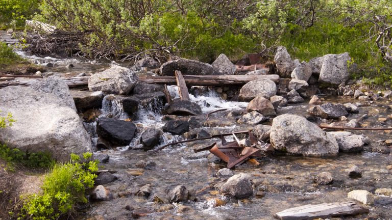 (<a href='http://www.shutterstock.com/pic-56866009/stock-photo-small-creek-with-mine-debris-running-through-independence-mine-hatchers-pass-alaska.html'>Gurgling brook</a> image courtesy of Shutterstock.com)