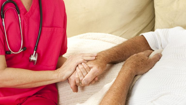 (<a href='http://www.shutterstock.com/pic-59821117/stock-photo-compassionate-home-health-nurse-holds-an-elderly-patient-s-hand.html?src=csl_recent_image-1'>Palliative care</a> image courtesy of Shutterstock.com)