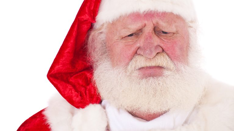 (<a href='http://www.shutterstock.com/pic-110283191/stock-photo-portrait-of-santa-claus-with-severe-look-all-on-white-background.html'>Sad Santa</a> image courtesy of Shutterstock.com)