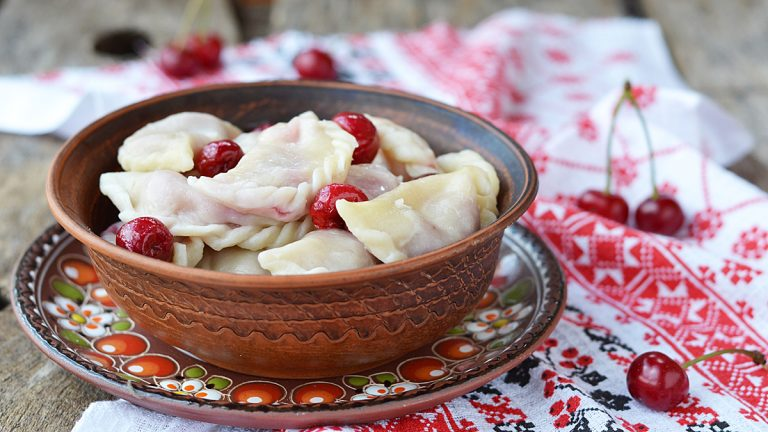 (<a href='http://www.shutterstock.com/pic-142099240/stock-photo-vareniki-with-cherry-on-the-ceramic-bowl.html'>Sour-cherry varenyky image</a> courtesy of Shutterstock.com)