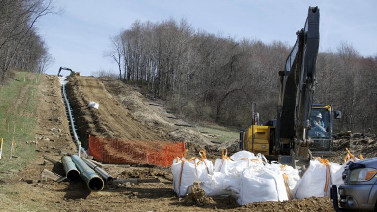 In this April 17, 2014 photo, workers construct a gas pipeline in Harmony, Pa. In a new development over the planned PennEast pipeline in the eastern part of the state, PSEG Power may sell its share. (Keith Srakocic/AP Photo)