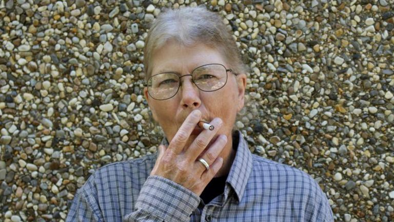 April Anderson is trying to quit smoking after forty years. She's HIV positive, which means the negative health effects of smoking are even greater her. (Morgan Springer/for WHYY)