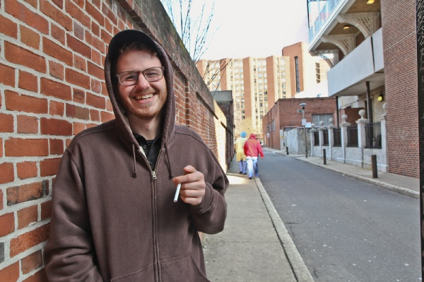 <p>&lt;p&gt;Andrew Kornrunph works at the hospital coffee shop and takes smoke breaks in the alley across the street. He said that paying higher premiums on his health insurance is fine with him. (Kimberly Paynter/WHYY)&lt;/p&gt;</p>