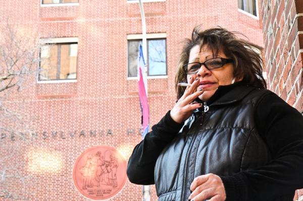 <p>&lt;p&gt;Hospital tech Maribel Bembischew takes a smoke on her break outside Pennsylvania Hospital. (Kimberly Paynter/WHYY)&lt;/p&gt;</p>