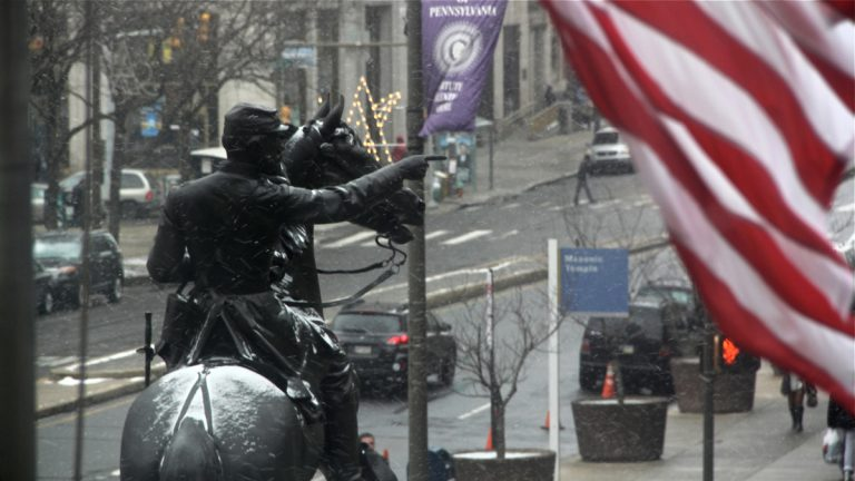 The statie of Major General John Fulton Reynolds and his horse is dusted by snow in front of City Hall as the storm develops. (Emma Lee/WHYY)