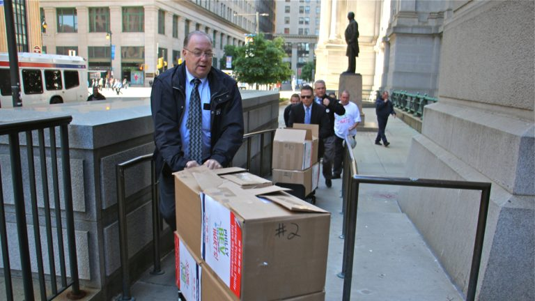 Representatives of Ax the Bev Tax, a coalition opposed to Philadelphia's sweetened beverage tax, deliver boxes of petitions and letters to City Hall. (Emma Lee/WHYY)