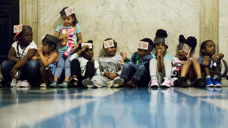 Children sat in the corridors of City Hall in Philadelphia, Wednesday, June 8, 2016. Philadelphia City Council is set to consider a sugary drink tax that Philadelphia Mayor Jim Kenney wants to pay for universal prekindergarten, community schools, park improvements, and fill a whole in the city's fund balance. (AP Photo/Matt Rourke)